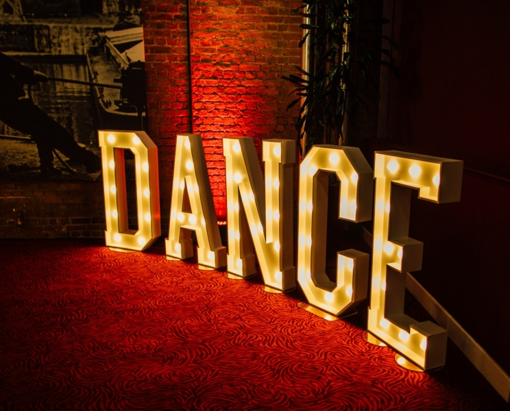 DANCE letter lights at The Place Aparthotel, Manchester