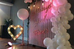 Rustic Ceremony Backdrop with Contemporary Balloon Arch