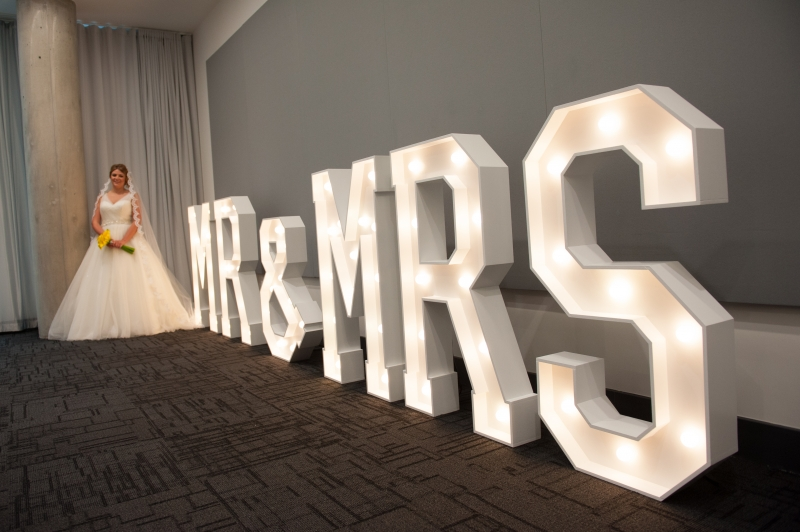 A beautiful bride with our sparkly MR & MRS letter lights at the Innside, Manchester