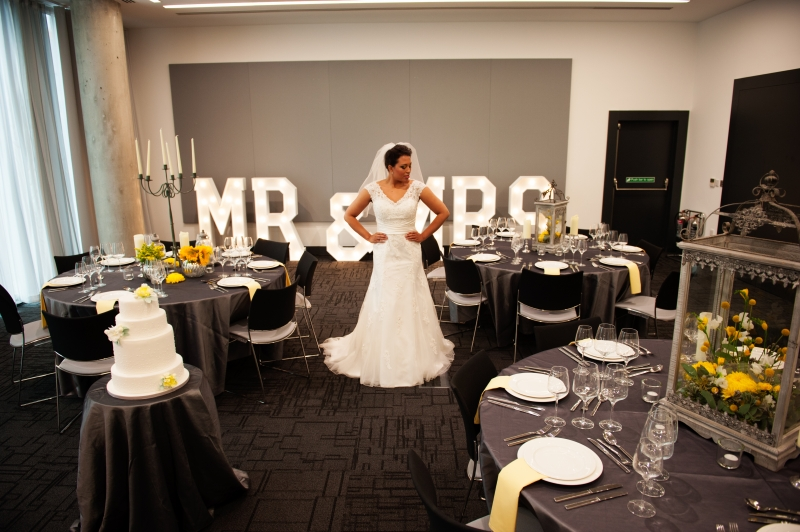 A beautiful bride in front of our light up letters