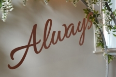 Metal Scriptive 'Always' signage.