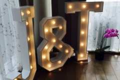 J & T letter lights providing the perfect party ambience to a wedding celebration
